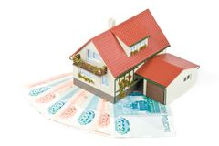 деньги миниатюры дома Стоковые Изображения RF