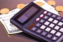 Деньги и чалькулятор Стоковые Изображения RF