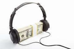 деньги наушников Стоковое Фото