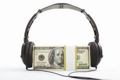 деньги наушников Стоковая Фотография