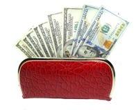 Деньги наличных денег доллара в красном бумажнике Стоковое Изображение