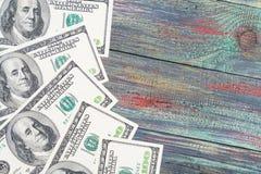 Деньги на покрашенной деревянной предпосылке Стоковая Фотография