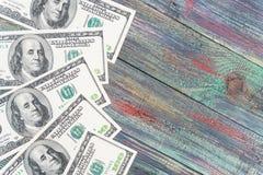 Деньги на покрашенной деревянной предпосылке Стоковые Фотографии RF