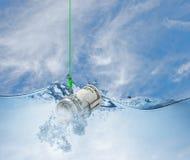 Деньги на рыболовном крючке в воде Стоковые Изображения