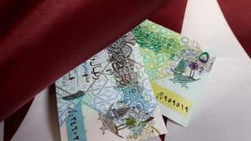 Деньги на флаге Катара акции видеоматериалы