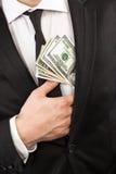 Деньги около сердца Стоковое фото RF