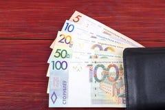 Деньги от Беларуси в черном бумажнике Стоковое Изображение RF