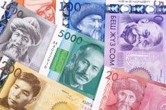 Деньги от Кыргызстана, предпосылки стоковые изображения