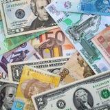 Деньги от различных долларов стран, евро, hryvnia, рублей Стоковая Фотография RF