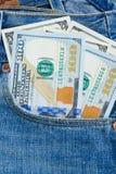 Деньги доллара в карманн Стоковое Изображение