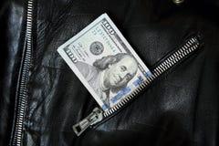 Деньги долларовых банкнот США в куртке Стоковое Фото