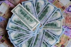 Деньги переносили между странами, namely США и Украина Стоковое фото RF