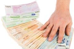 Деньги разбросанные человеком Стоковые Фото