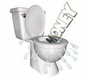 Деньги расточительствовали слово потопленные вниз с туалета Стоковые Изображения RF