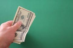 деньги руки ваши Стоковые Изображения RF