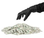 деньги руки перчатки стоковая фотография