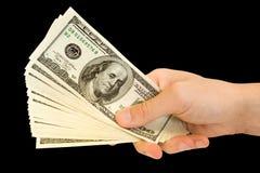 деньги руки Стоковая Фотография