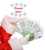 деньги руки santa claus Стоковые Изображения