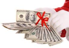 деньги руки santa claus Стоковая Фотография