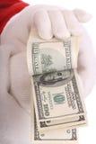 деньги руки santa claus Стоковые Фотографии RF