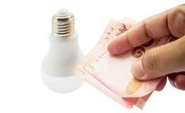 Деньги сбережений концепции путем использование энергии Стоковые Изображения RF