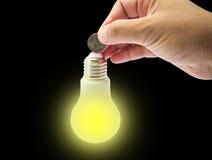 Деньги сбережений концепции путем использование энергии Стоковая Фотография