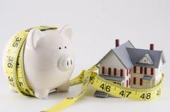 Деньги сбережений на напряженном бюджете Стоковые Изображения RF