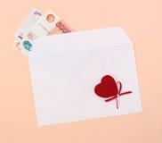 деньги сердца габарита Стоковая Фотография RF