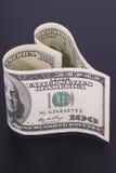 деньги сердца сформировали Стоковое Изображение RF
