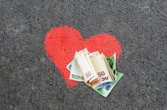 деньги сердца Стоковые Фото
