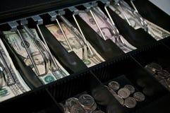 Деньги США в открытом ящике наличных денег стоковое изображение