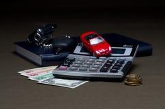 Деньги с калькулятором и машиной Стоковое Изображение
