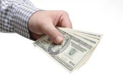 Деньги удерживания руки 20 долларов Стоковые Изображения RF