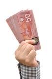 Деньги удерживания руки 50 долларов Стоковая Фотография RF