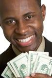 деньги человека удерживания стоковое фото rf