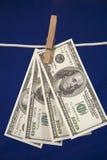 деньги clothesline вися Стоковое фото RF