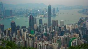 День к видео timelapse ночи взгляда горизонта города Гонконга от упущения пика времени 4K видеоматериал
