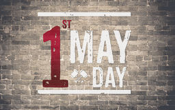День 1-ое мая (международный День Трудаа) на кирпичной стене, концепции праздника Стоковое Изображение RF