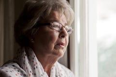 Депрессия старшей женщины стоковое фото
