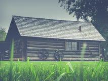 Деревенская ретро фильтрованная бревенчатая хижина Стоковые Фото
