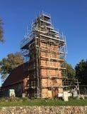 Деревенская церковь под реновацией, Польша стоковые фото