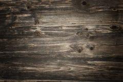 Деревенские темные деревянные планки с освещением виньетки стоковые фото