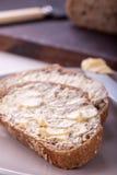Деревенский хлеб с маслом Стоковые Изображения