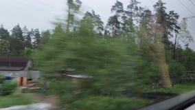 Деревня от окна поезда видеоматериал