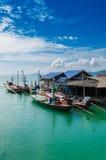 Деревня рыболова на ясном море в временени Стоковое фото RF