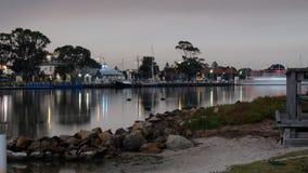 Деревня с другой стороны реки стоковые изображения rf