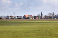 Деревня Maasdam в голландском ландшафте польдера стоковое изображение
