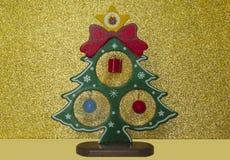 Дерево Нового Года на золотой предпосылке Стоковое Изображение