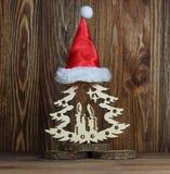 Дерево Нового Года на stub в красной крышке Стоковые Фотографии RF