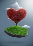 Дерево сердца на приостанавливанном утесе Стоковые Изображения